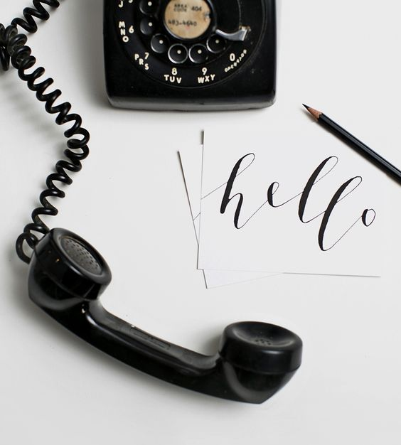 hello with black rotary phone