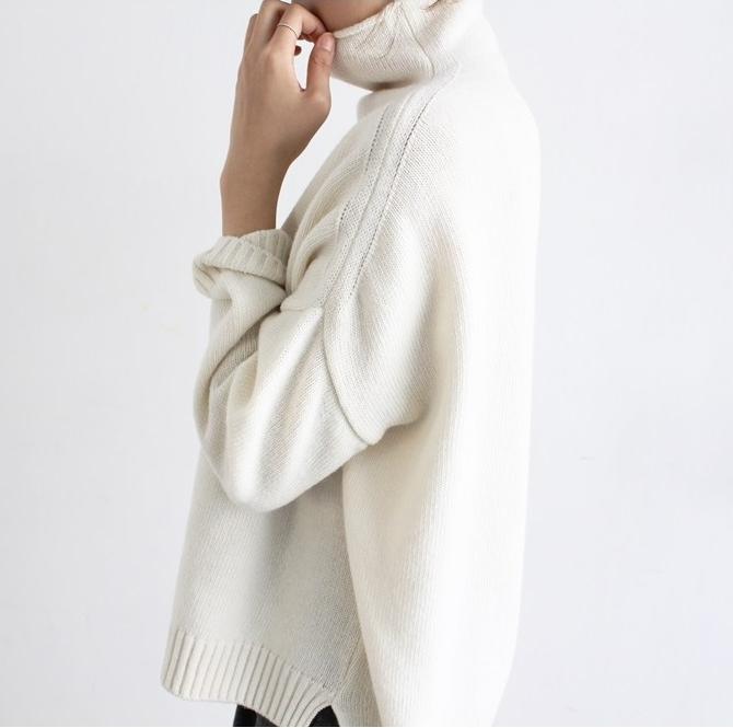 girl in white sweater pondering