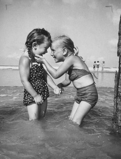 two little girls in swimsuits